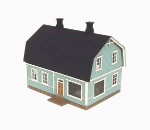 Mansardikattoinen talo kaupalla